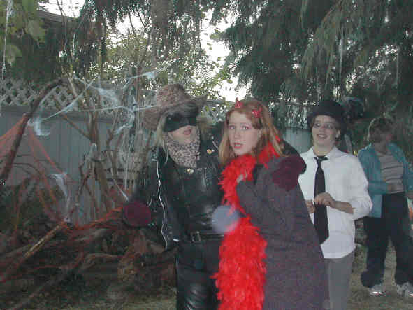 # 4 - 2003 (Val, our costume designer is the masked mistress on the left)